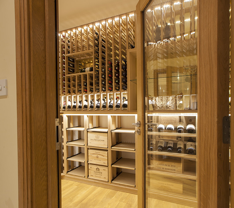 Wine cellar made with european and american oak for Wine room ideas