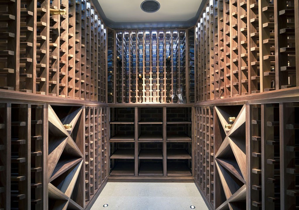 Wine cellar made with walnut carlo garn Cellar designs