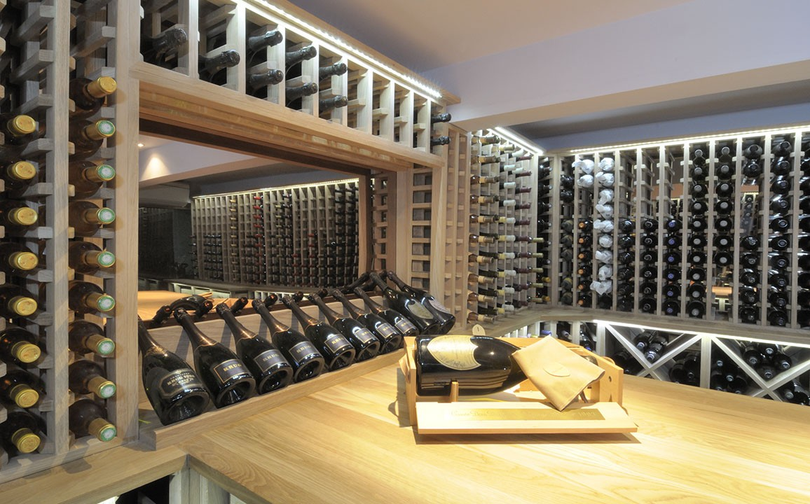 Wine cellar made with oak carlo garn for Wine cellar layout
